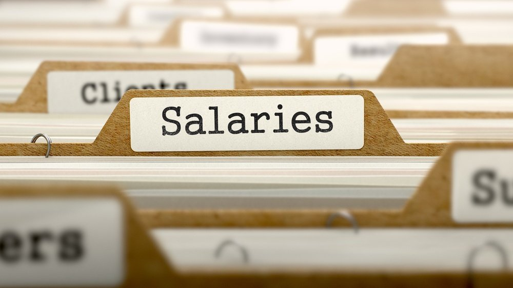 Salaries Concept. Word on Folder Register of Card Index. Selective Focus.